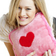 Woman holding a pillow with heart — Stok Fotoğraf #3950283