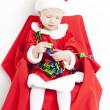 Little girl as Santa Claus - Stock Photo