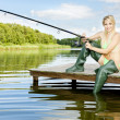 Stock Photo: Fishing woman