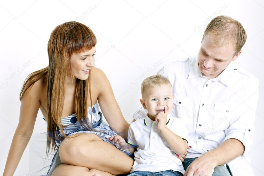 Portrait of parents with their little son  Stock Photo #4167572