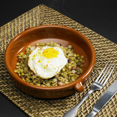 Lentils with fried egg — Stock Photo