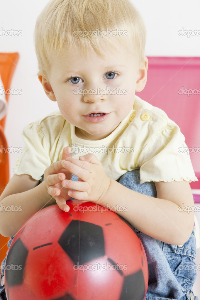 Portrait of toddler with a ball  Stock Photo #4355826