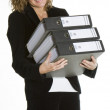 Foto Stock: Businesswomwith folders