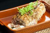 Wieprzowina roll wypełnione kiełbaski, jajka, migdały i ruccola — Zdjęcie stockowe