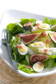 Salad with figs and quail eggs — Stock Photo