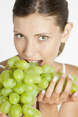 Portrait of young woman with grape — Stock Photo