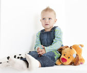 Sitting toddler with toys — Stock Photo