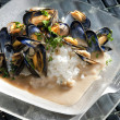 Mussels on curry paste - Stock Photo
