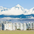 Poprad with Vysoke Tatry (High Tatras) at background, Slovakia - Stock Photo