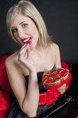 Woman with Valentine chocolate — Stock Photo