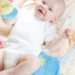 Baby girl lying down on playing mat — Stock Photo #4652971