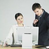 Businesspeople at computer — Stock Photo