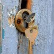Two keys in the old door lock — Stock Photo