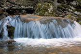 Cascade of mountain river — Stock Photo