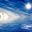 Beautiful sun over clouds and water — Stock Photo