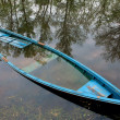 Flooded boat in water — Stock Photo