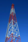 Radio tower with blue sky background — Stock Photo