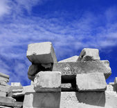 Concrete blocks on the sky background — Stock Photo