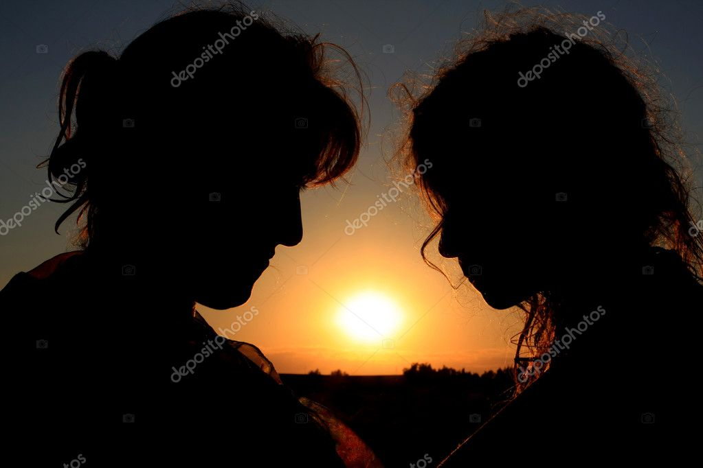 Mother and daughter silhouettes on sunset background — Stock Photo #2803102