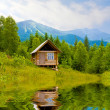 Stock Photo: Wooden house in mountains near lake