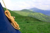 Yellow rope on mountain background — Stock Photo