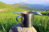 Steel cup and spoon — Stock Photo