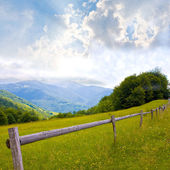Fence in mountains — Stock Photo