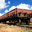 Railwar carriage on rails - Stock Photo