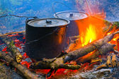Two smoke tourist kettle on fire — Stock Photo