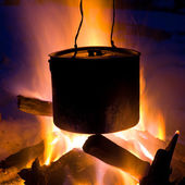 Tourists kettle on campfire — Stock Photo