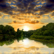 Foto Stock: Sunsetr on river