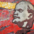 Lenin mosaic on monument's wall - Stock Photo