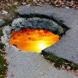 Sunset on hole in road — Stock Photo
