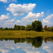 Stock Photo: Landscape with nice clouds over lake
