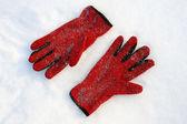 Red gloves on snow — Foto de Stock