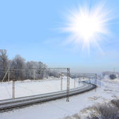 White sun over railway — Stock Photo