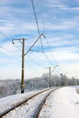 Electrified railway at winter — Stok fotoğraf