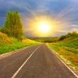 Rural road to sunset — Stock Photo