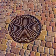 Stock Photo: Manhole cover on pavement