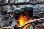 Two kettles on campfire — Stock Photo