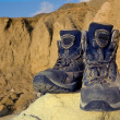 Tourists boots on stone in mountains — Stock Photo