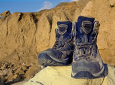 Tourists boots on stone in mountains — Photo