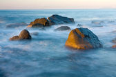 Group of stones in water of sea — Stock Photo