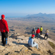 Hikers watch the terrain — Stock Photo