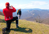 Hiker take a picture — Stock Photo