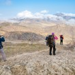 Hikers enjoy a mountain landscape — Stock Photo