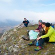 Hikers sit on the peak — Stock Photo