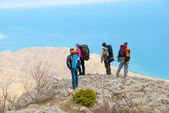 Hikers watch the terrain — Stock Photo