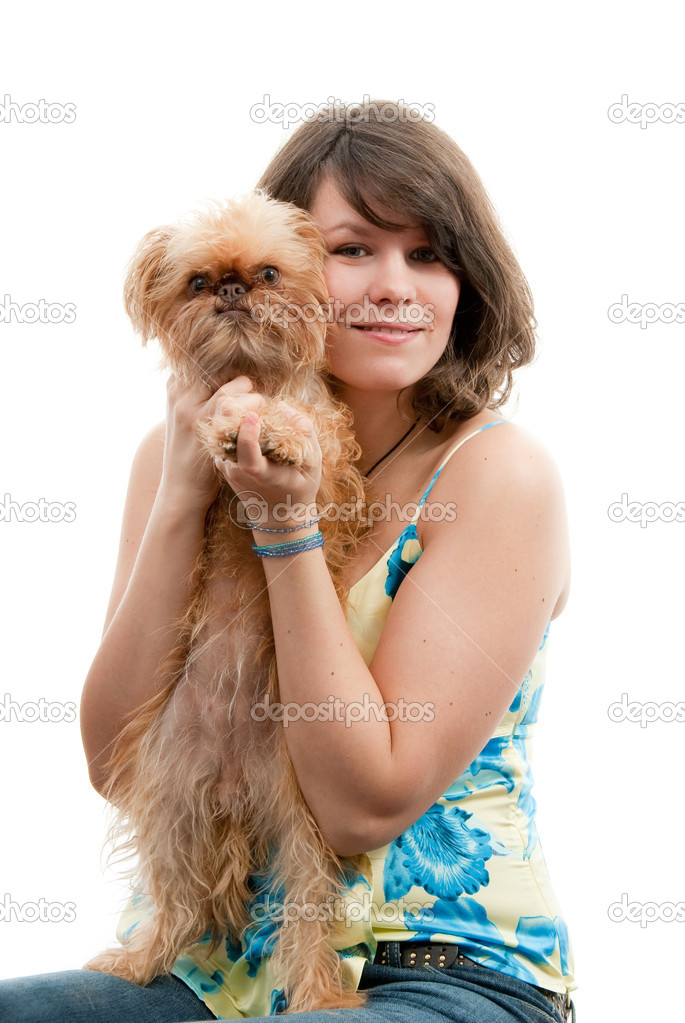 Young woman with dog on her knees. Breed - Griffon Bruxellois. — Stock Photo #3189012