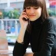 Young girl speaking on a mobile — Stockfoto